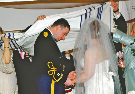 Alex and Rachel get married under a tallit in a Jewish ceremony