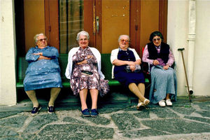 French ladies at rest, watching the passing parade