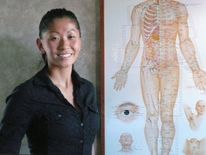 an acupuncturist with her chart
